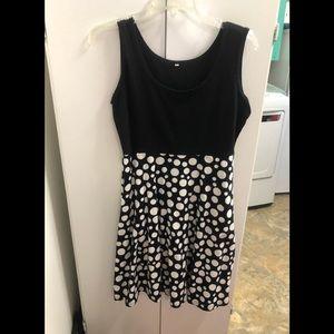 Black sleeveless dress with white polka dots